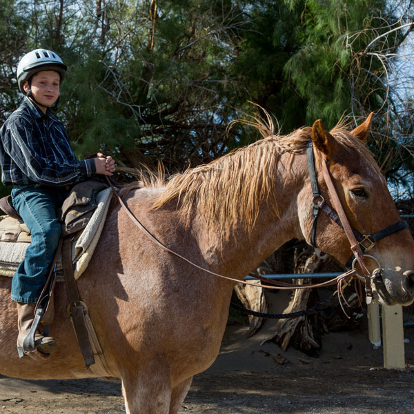 Furnace Creek Stables Boy on Horse