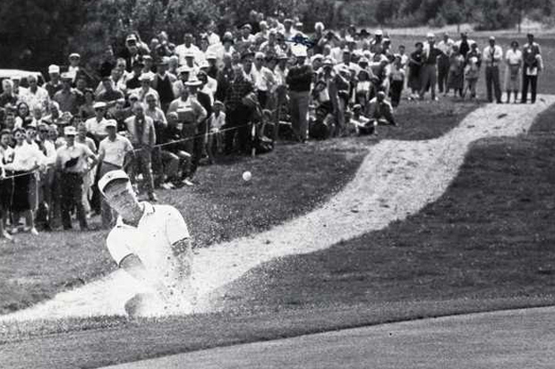 Jack Nicklaus hitting out of the sand trap
