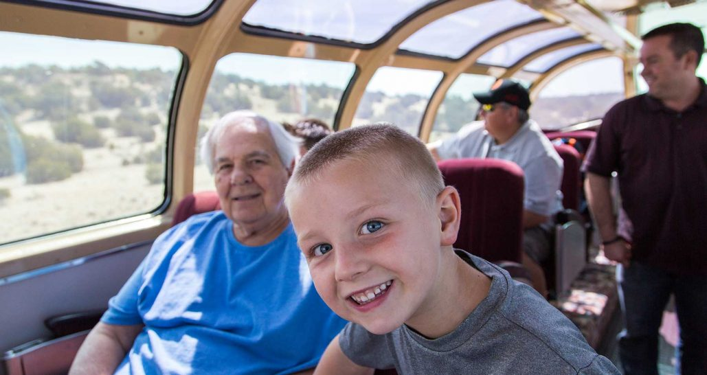 Kid with grandfather on train