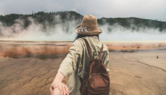 Rear View of Couple Holding Hands at Yellowstone